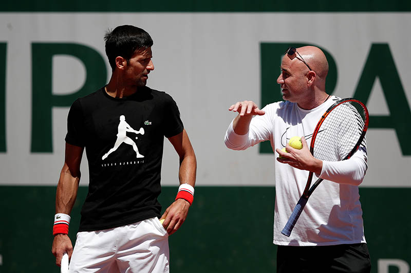 Novak Djokovic of Serbia and his coach Andre Agassi during a training session. Photo: Reuters