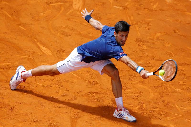 Djokovic returns a ball. Photo: Reuters