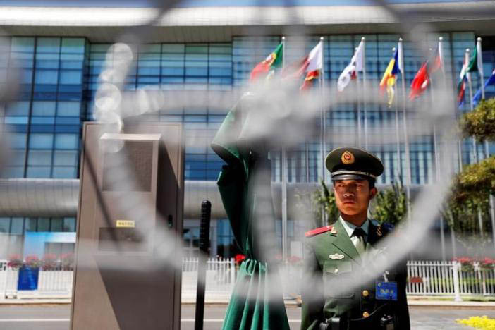 A paramilitary policemen secures the venue of the Belt and Road Forum in Beijing, China, May 14, 2017. Photo: Reuters