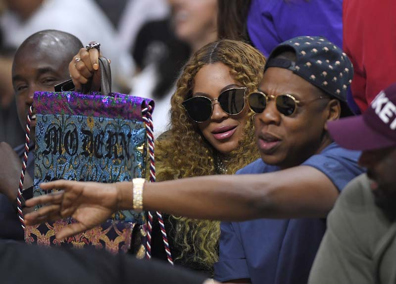 FILE - Beyonce and Jay Z watch during the first half in Game 7 of an NBA basketball first-round playoff series between the Los Angeles Clippers and the Utah Jazz in Los Angeles, on April 30, 2017. Photo: AP
