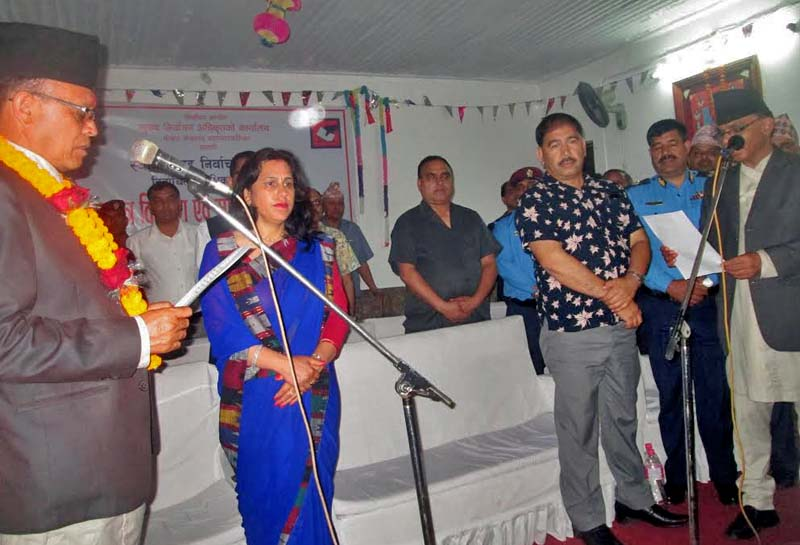 Newly elected mayor of Pokhara-Lekhnath Metropolitan City Man Bahadur GC taking the oath of office and secrecy from the chief election officer, in Pokhara, on Sunday. Photo: THT