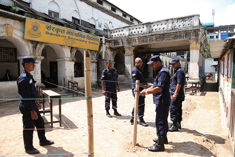 Security men setting up a polling booth in Bhotahiti, Kathmandu, on Saturday, May 14, 2017.