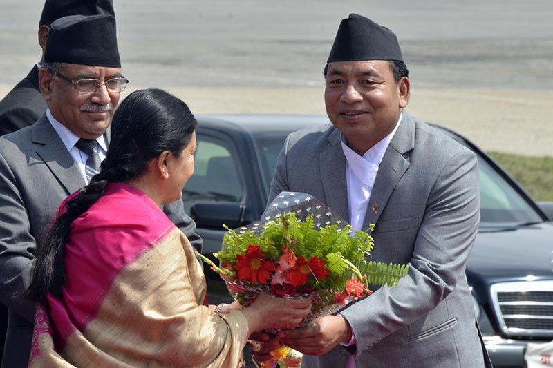 Vice-President Nanda Bahadur Pun (right) sees President Bidya Devi Bhandari off on her departure to Sri Lanka at Tribhuvan International Airport, Kathmandu, on Friday.