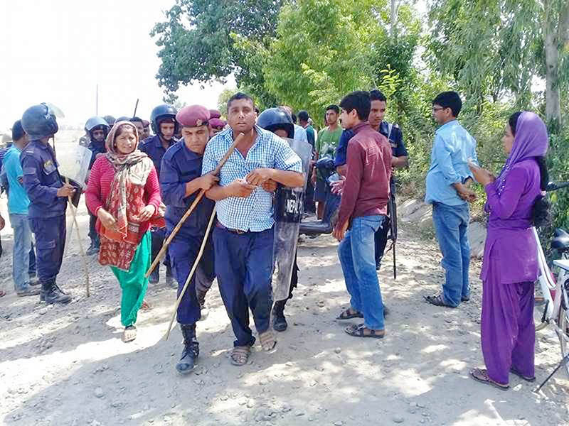 Locals being arrested by police after they demanded the closure of a crusher industry in Kanchanpur district, on Thursday, May 4, 2017. Photo: RSS
