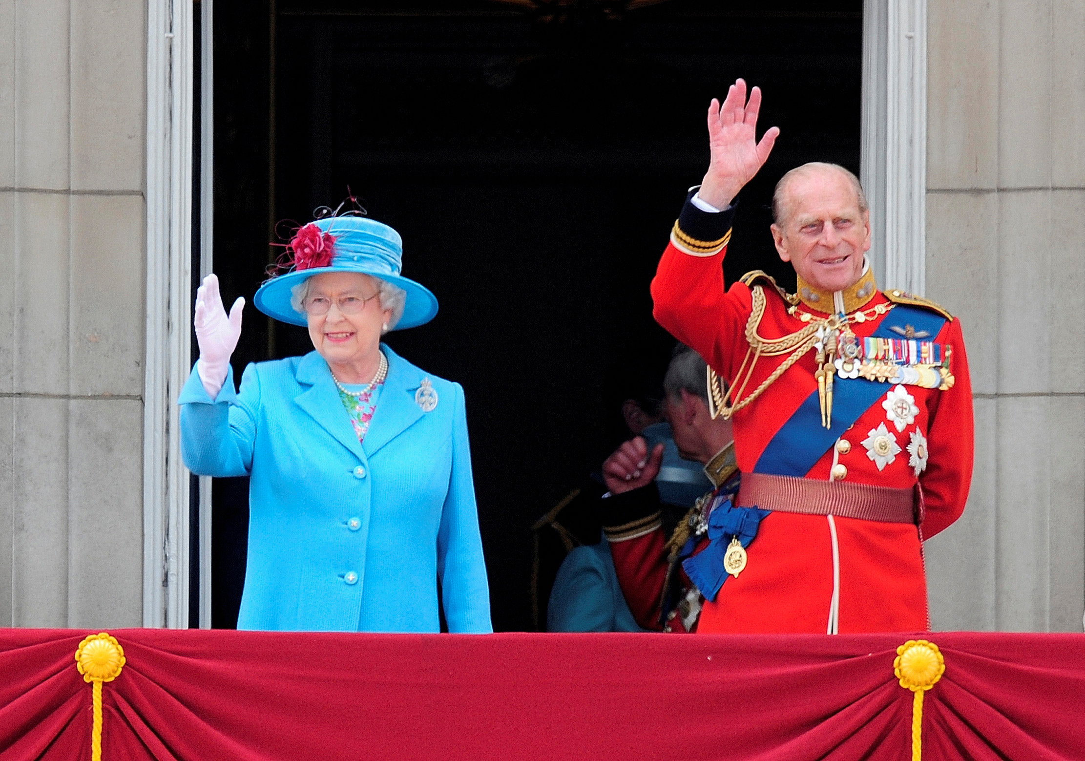 Britain's Queen Elizabeth and Prince Philip wave from the balcony of Buckingham Palace after attending the Trooping the Colour ceremony in London in this June 13, 2009 file photo. Photo: Reuters