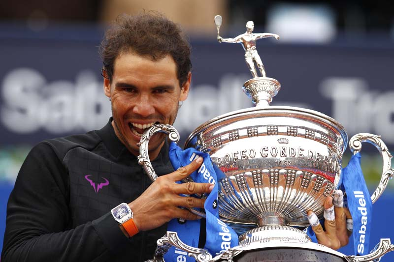 Rafael Nadal of Spain poses with the trophy after winning his men's finals match 6-4, 6-1 against Dominic Thiem of Austria during their singles final match at the Barcelona Open Tennis Tournament in Barcelona, Spain, on Sunday, April 30, 2017. Photo: AP
