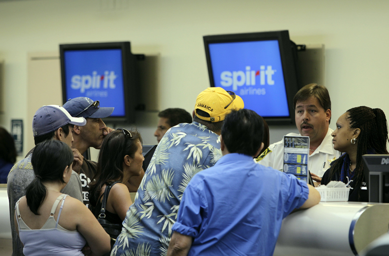 In this June 12, 2010, file photo, stranded passengers stand at the Spirit Airlines ticket counter at the Fort Lauderdale-Hollywood International Airport in Fort Lauderdale, Florida. Photo: AP