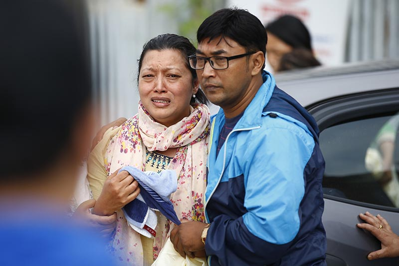 Relatives mourning the death of senior pilot Paras Kumar Rai and co-pilot Srijan Manandhar, who were killed on Saturday when a Summit (Goma) Air plane crashed at Lukla Airport, in Kathmandu, on Sunday, May 28, 2017. Skanda Gautam/THT