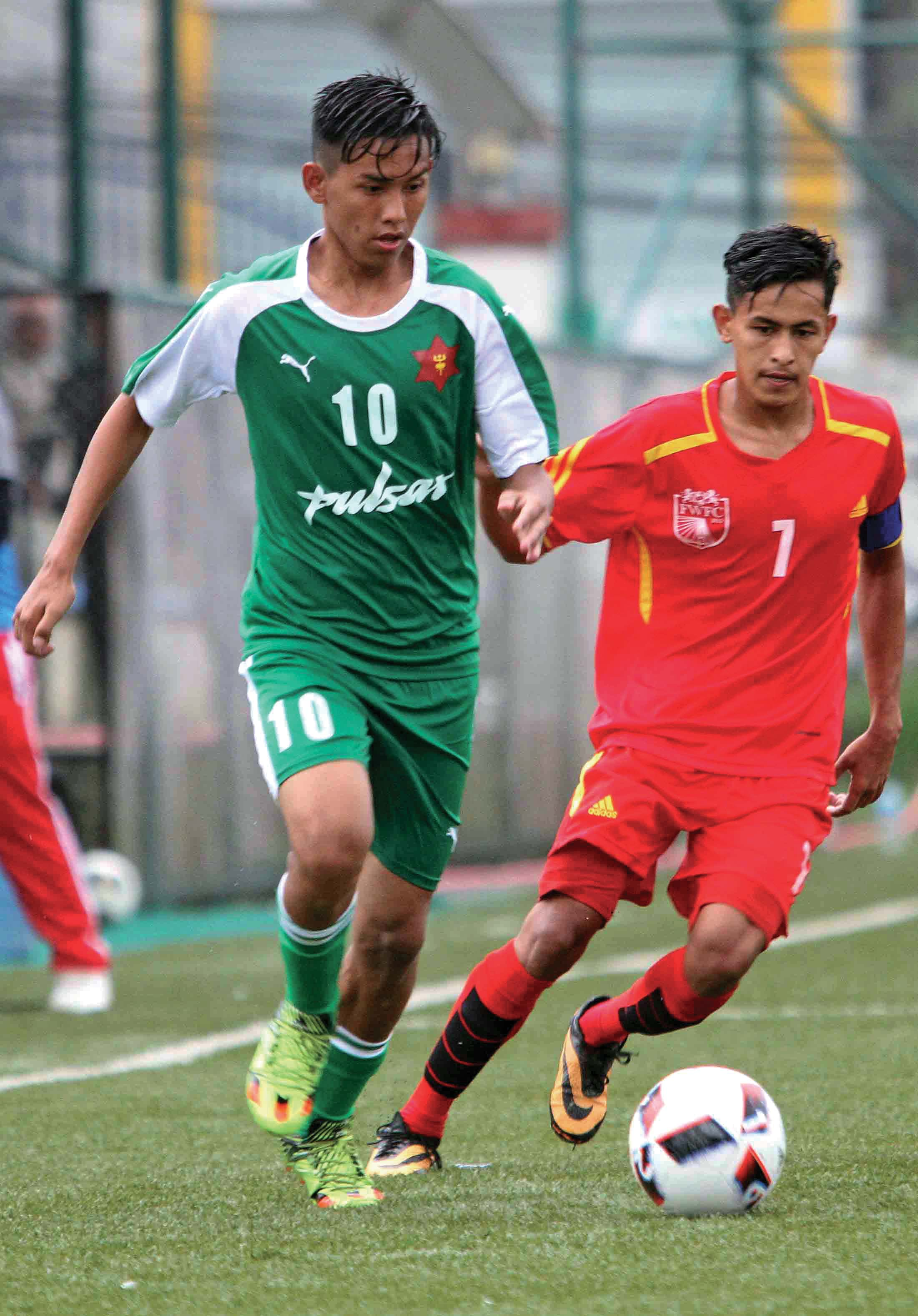 TAC's Prezen Tamang (left) and Far-western skipper Kamal Deuba vie for the ball during their Lalit Memorial U-18 Football Tournament match in Lalitpur on Saturday. Photo: THT