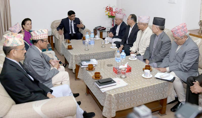 CPN-UML leaders drawing the attention of Election Commissioners to probe into the incident related to tearing of ballot papers by themselves on May 30, 2017. Photo: RSS