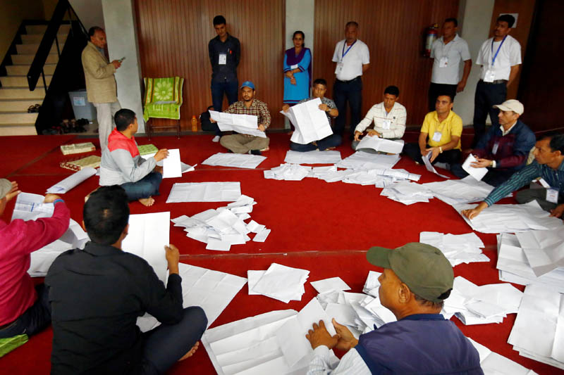 Officials from the election commission count votes a day after the local election of municipalities and villages representatives in Kathmandu, Nepal May 15, 2017. Photo: Reuters