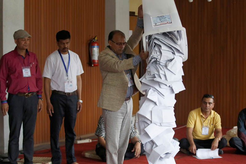 An official from the election commission pours the ballot papers from the box, as officials start counting the votes, a day after the local election of municipalities and villages representatives in Kathmandu, Nepal May 15, 2017. Photo: Reuters