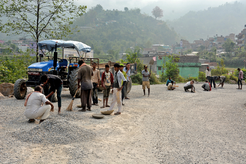 Workers preparing to blacktop the Hatiya-Manewa road section in Baglung, on Saturday, May 20, 2017. Photo: RSS