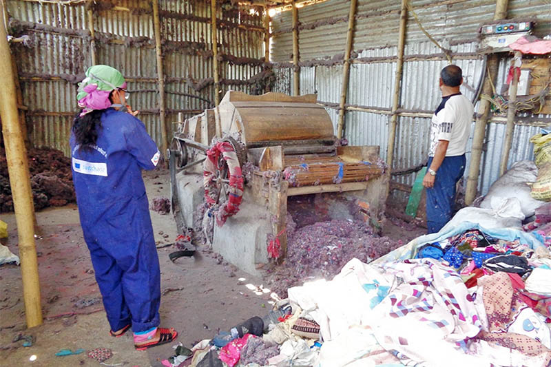 FILE - Labourers are seen working at a cotton refining industry in Ilam district, on Thursday, May 4, 2017. Photo: RSS