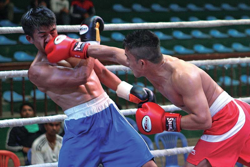 Yadav Thapa (right) of Dancing Yak lands a punch on the face of Yurendra Budha Magar of Max Boxing Promotion during their lightweight bout of the Champ of Champions in nKathmandu on Saturday. Photo: Udipt Singh Chhetry / THT