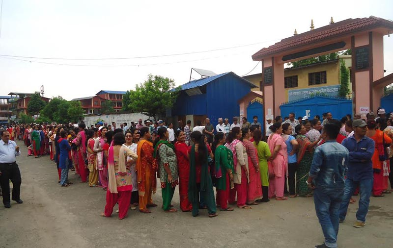 Voters formed a line as early as 6:30 am on Sunday, May 14, 2017 to cast their votes at Narayani Namuma Higher Secondary School in Bharatpur Metropolitan City-10, Chitwan. Photo: Tilak Ram Rimal
