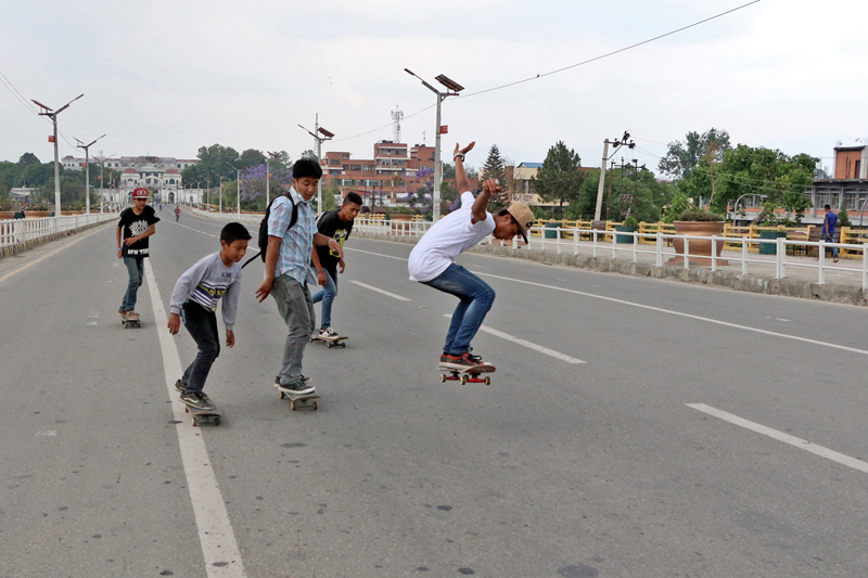 Youth are seen enjoying skating along the Ratnapark-Singhadarbar road section in Kathmandu, on Sunday, May 14, 2017. The road wears a deserted look as vehicles are prohibited for local level elections. Photo: RSS