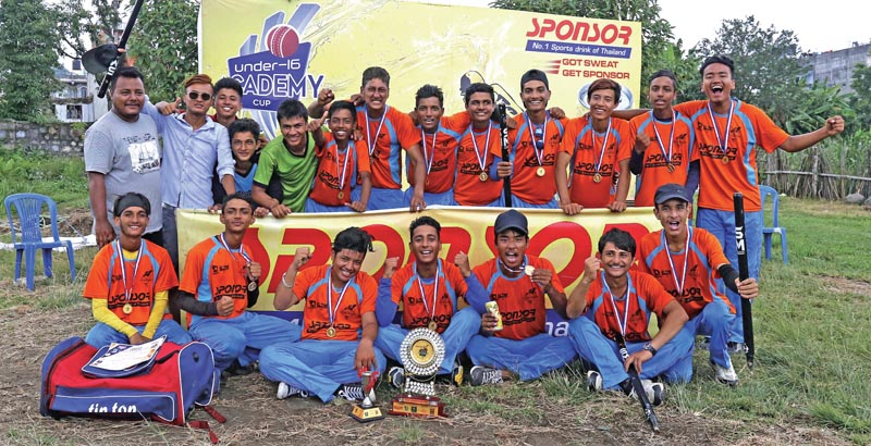 Players and officials of Makawanpur Cricket Academy celebrate after winning the Sponsor U-16 Academy Cup in Pokhara, on Saturday. Photo Courtesy: cricketingnepal