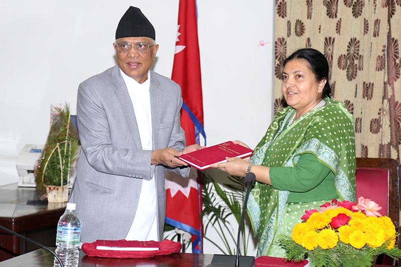 Acting Chief Justice Gopal Prasad Parajuli presenting the Annual Report of the Judicial Council and the Judicial Service Commission (Fiscal Year 2015/16) to President Bidya Devi Bhandari at the latteru2019s office in Sital Niwas on June 22, 2017. Photo: RSS