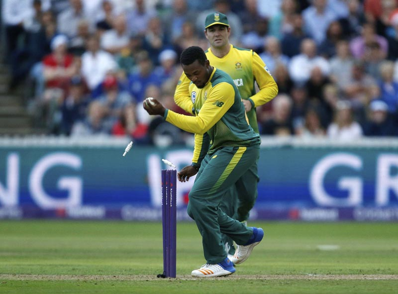 South Africa's Andile Phehlukwayo runs out England's Liam Livingston during the second T20 Blast match against England at the Cooper Associates County Ground, Taunton, England, Friday June 23, 2017. Photo: Paul Harding/PA via AP