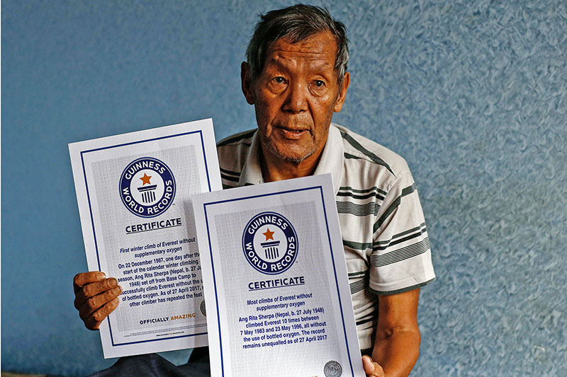 Ang Rita Sherpa pose with the Guiness World Record Certificates. Courtesy: Thaneswar Guragai