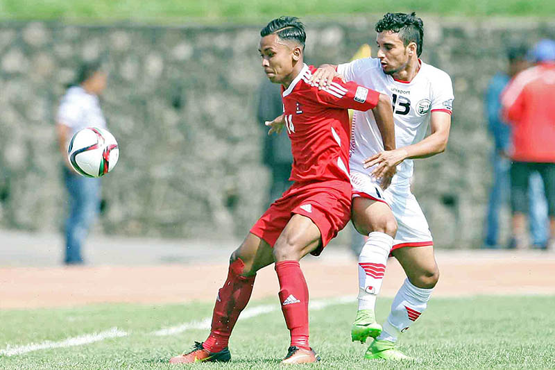 Nepal's Anjan Bista holds Yemani player during AFC 2019 Asia Cup Qualifiers in Kathmandu, on Tuesday, June 13, 2017. Photo: Udipt Singh Chhetry