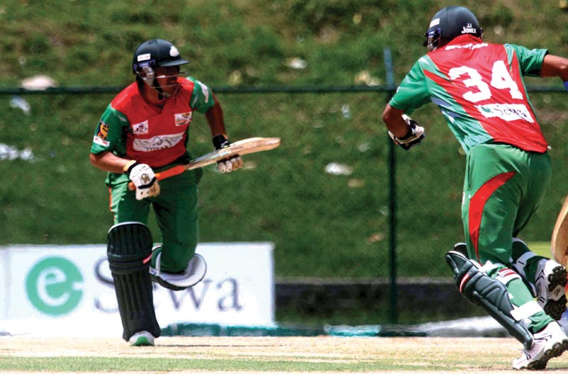 Bangladesh Tigers batsmen running between the wickets against India Stars during their Asian Club Premier League match at the TU Stadium in Kathmandu, on Tuesday. Photo: THT