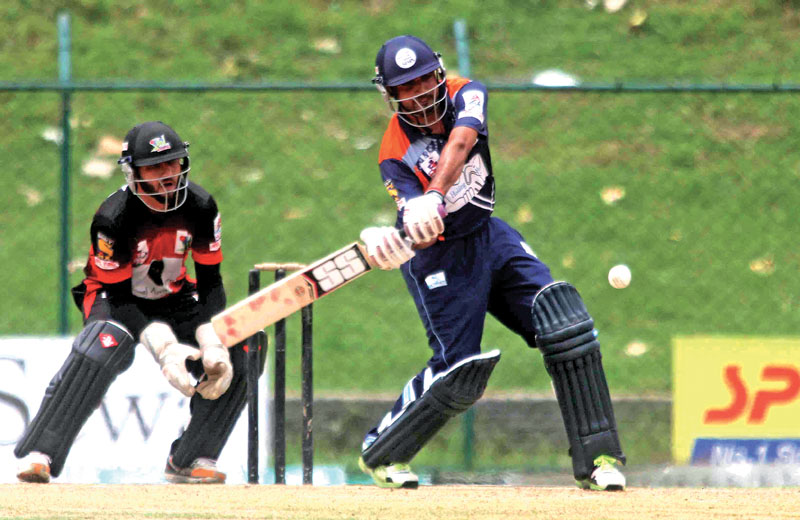 A player of Indian Stars plays a shot as Dubai Warriours Wicketkeeper looks on during their Asian Club Premier League match at the TU Stadium in Kathmandu on Wenesday, June 28, 2017. Photo: Udipt Singh Chhetry/ THT