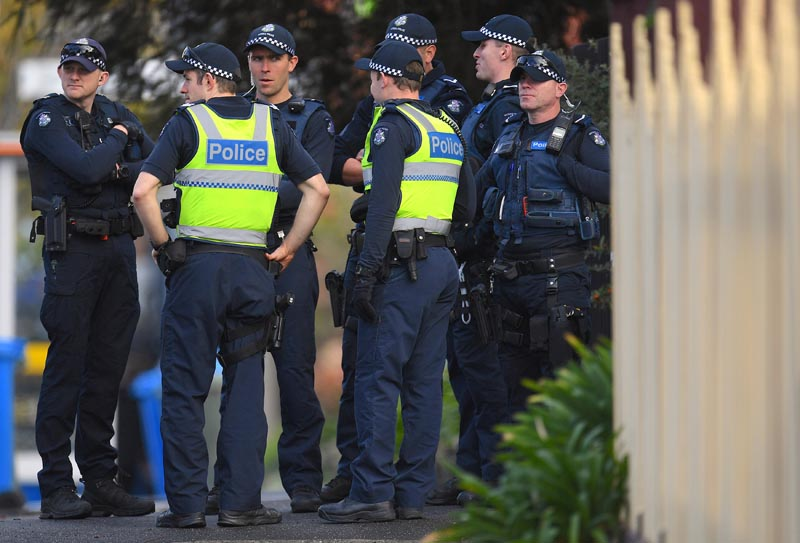 Australian police stand at the site of a siege at the Buckingham Serviced Apartments in Melbourne, Australia, on June 6, 2017. Photo:  AAP/Julian Smith/via Reuters