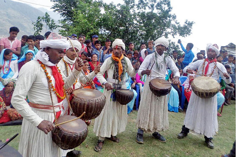 Members of Dalit Community play a traditional Damaha musical instrument in Budiganga Municipality, in Bajura district, on Friday, June 2, 2017. Photo: RSS