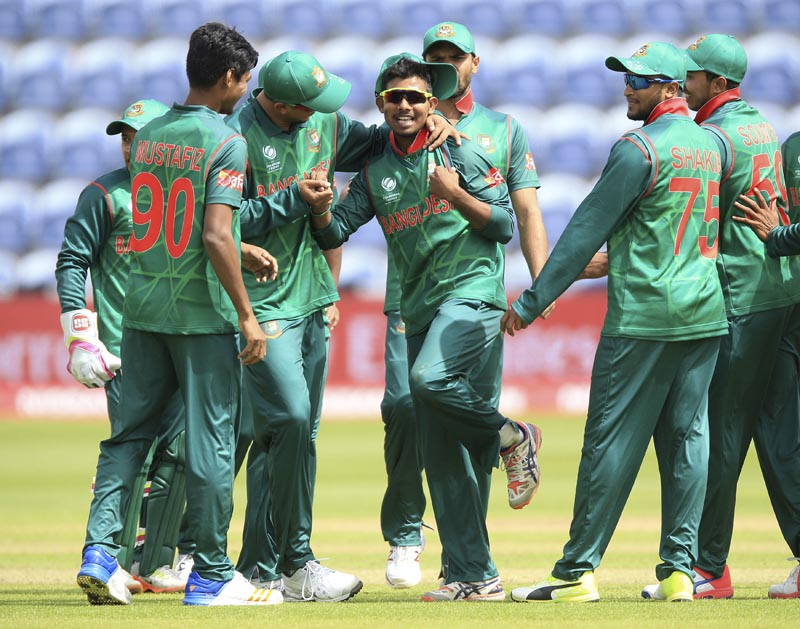 Bangladesh's Mosaddek Hossain, (centre), celebrates after taking the wicket of New Zealand's James Neesham during the ICC Champions Trophy, Group A cricket match between New Zealand and Bangladesh, at Sophia Gardens, Cardiff, Wales, on Friday, June 9, 2017. Photo: Nigel French/PA via AP