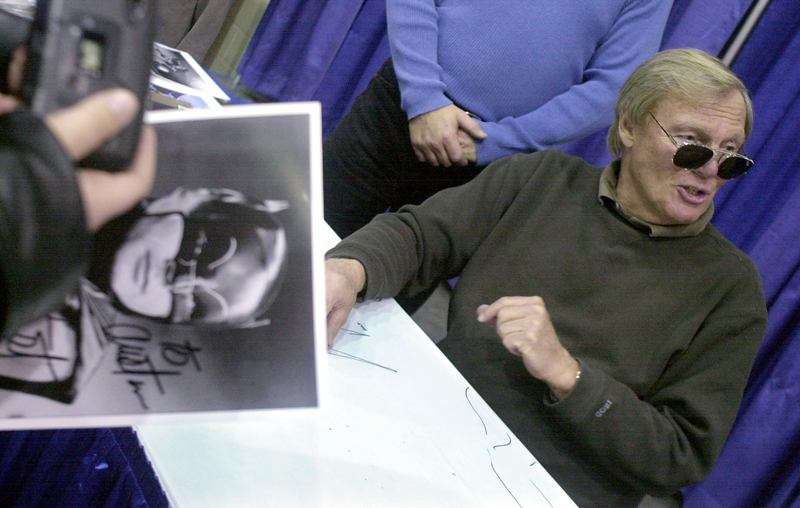 FILE - In this February 23, 2002 file photo, a fan holds a signed photograph of actor Adam West, right, during the 50th Autorama in Detroit. Photo: AP