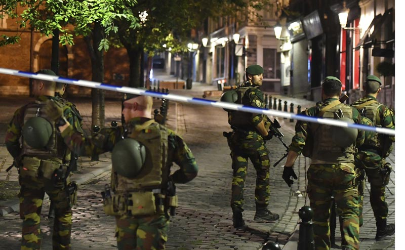 Belgian Army soldiers patrol near Central Station in Brussels after a reported explosion, on Tuesday, June 20, 2017. Photo: AP