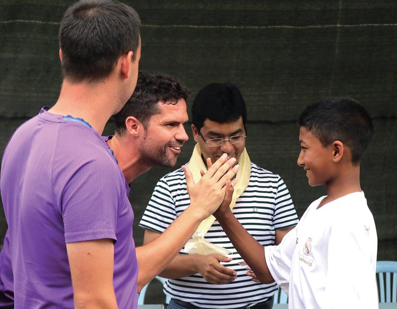 Nepal's Bidit Man Tuladhar is congratulated by coaches after being selected for the training camp at the Singapore-based Real Madrid Foundation, in Kathmandu on Friday. Photo: THT
