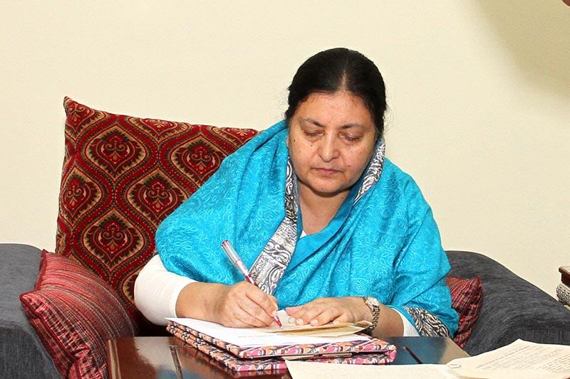 President Bidya Devi Bhandari certifies a bill endorsed by the Parliament at Sheetal Niwas, on Monday, June 12, 2017. Courtesy: President's Office