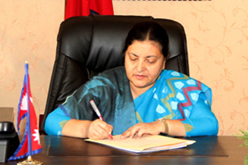 President Bidya Devi Bhandari certifies the bill of local level election endorsed by the Parliament, on Friday, June 9, 2917. Courtesy: President's Office