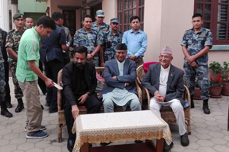 Nepali Congress President Sher Bahadur Deuba (centre), the sole candidate for the post of Prime Minister, meets CPN-UML Chairman KP Sharma Oli (right) at latter's residence in Balkot of Bhaktapur on Saturday, June 3, 2017. Deputy Prime Minister and NC leader Bimalendra Nidhi (left) accompanies Deuba during the meeting.Photo: RSS