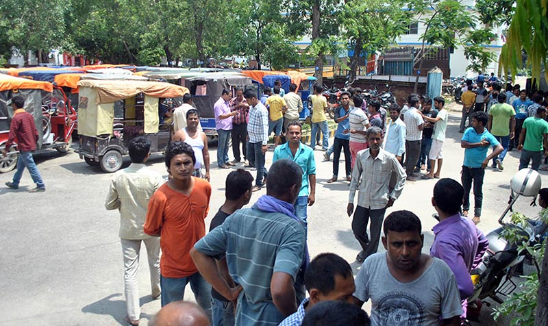 E-rickshaw drivers gathering on a street to pressure the local administration after the district traffic police seized illegally operated vehicles, in Birgunj, Parsa, on Thursday, June 8, 2017. Photo: THT.