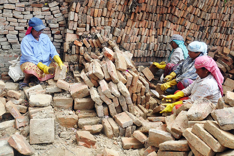 Women clean bricks of Kedarnath Temple demolished during the earthquake, for the reconstruction of monument at the Bhaktapur Durbar Square, on Sunday, June 11, 2017. Photo: RSS