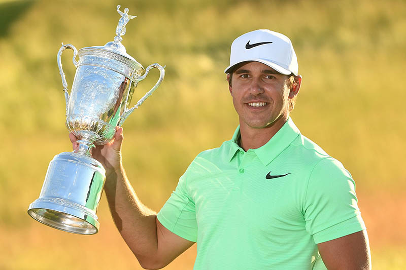 Jun 18, 2017; Erin, WI, USA; Brooks Koepka poses with the trophy after winning the US Open golf tournament at Erin Hills.  Mandatory Credit: Rob Schumacher-USA TODAY Sports