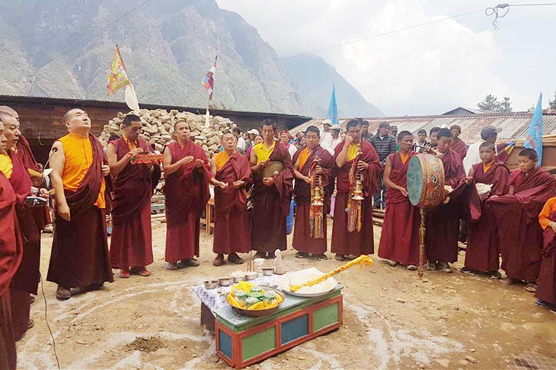Buddhist monks offering prayers at the foundation stone laying ceremony at a monastery being rebuilt by Um Hong Gil Human Foundation, in Gumela,Solukhumbu, on Wednesday, June 21, 2017. Photo: THT
