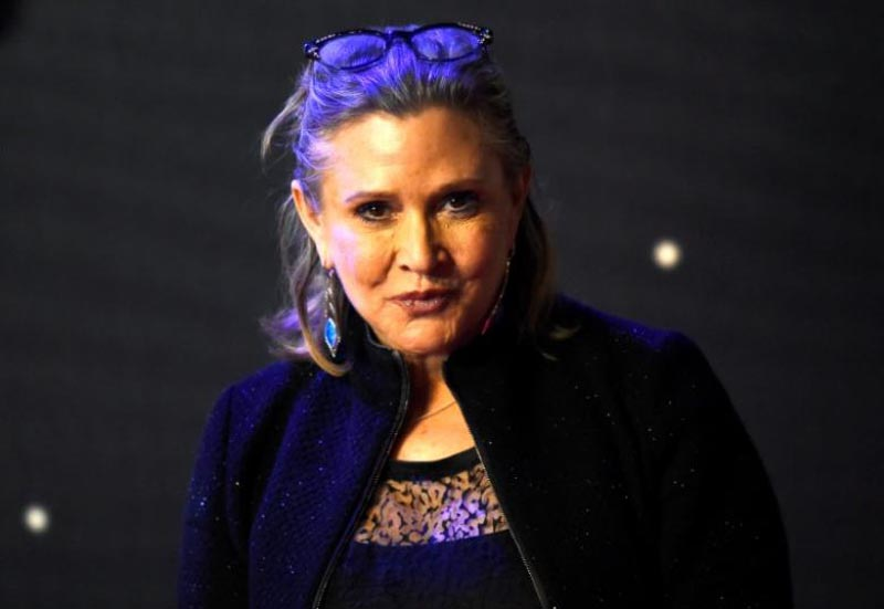 Carrie Fisher poses for cameras as she arrives at the European Premiere of ''Star Wars, The Force Awakens'' in Leicester Square, London, on December 16, 2015.