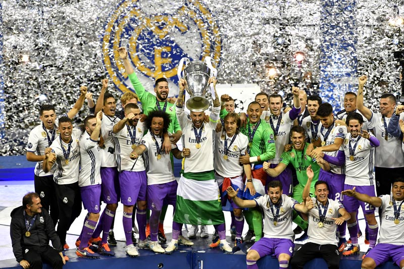 Real Madrid celebrate with the trophy after winning the UEFA Champions League Final match between Juventus and Real Madrid at the National Stadium of Wales, Cardiff, on June 3, 2017. Photo Reuters