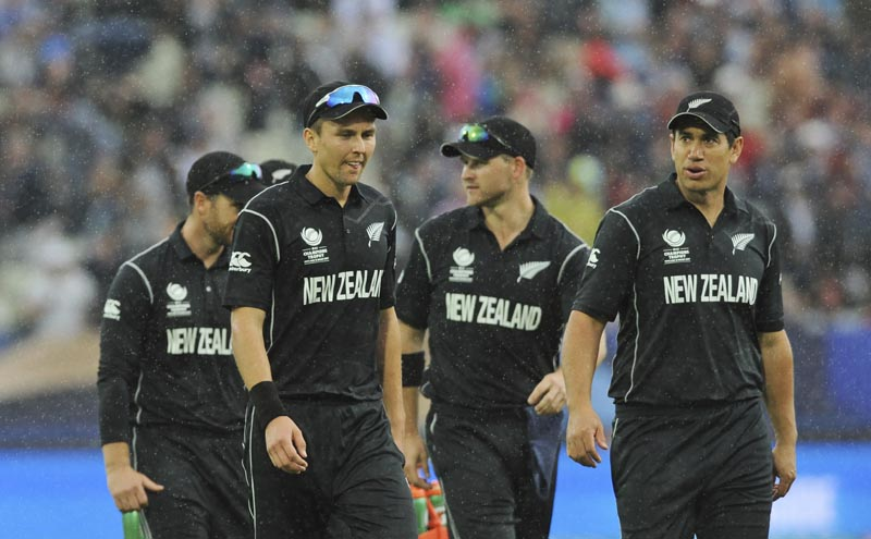 New Zealand's Trent Boult, (front left), and Ross Taylor, (right), walk back with teammates to the pavilion after rain disrupted play during the ICC Champions Trophy match between Australia and New Zealand at Edgbaston, in Birmingham, England, on Friday, June 2, 2017. Photo: AP