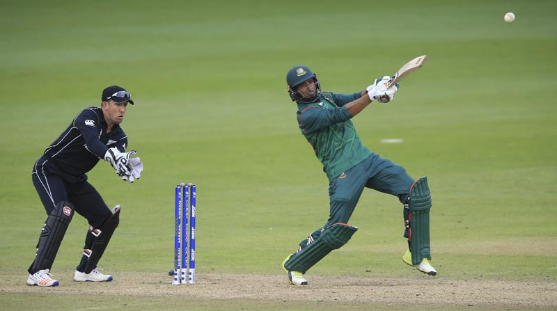 Bangladesh's Mahmudullah, (right), hits out during the ICC Champions Trophy, Group A cricket match between New Zealand and Bangladesh, at Sophia Gardens, Cardiff, Wales, on Friday June 9, 2017. Photo: Nigel French/PA via AP