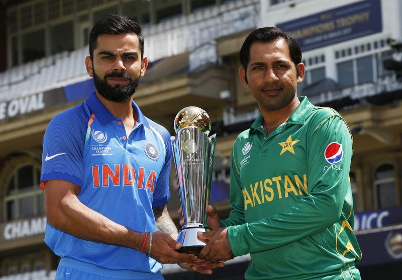Pakistan's Sarfraz Ahmed and India's Virat Kohli pose with the trophy, at The Oval, on June 17, 2017. Photo: Action Images via Reuters