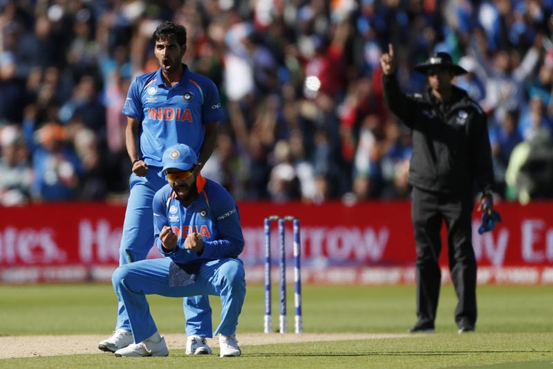 India's Bhuvneshwar Kumar (top) celebrates taking the wicket of Pakistan's Ahmed Shehzad with India's Virat Kohli in 2017 ICC Champions Trophy Group B match between India and Pakistan, at Edgbaston, on June 4, 2017. Photo: Action Images via Reuters