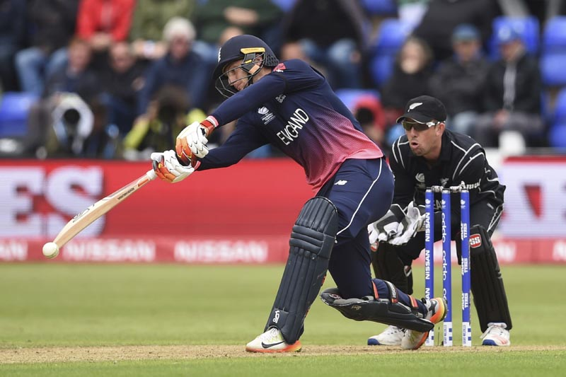 England's Jos Buttler hits out against New Zealand during the ICC Champions Trophy, Group A  cricket match  between England and New Zealand in Cardiff,  Wales, on Tuesday June 6, 2017. Photo: Joe Giddens/PA via AP