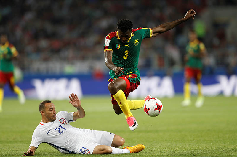 Cameroonu2019s Andre Zambo Anguissa in action with Chileu2019s Marcelo Diaz. Photo: Reuters