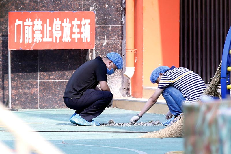 Investigators work at the scene of an explosion inside a kindergarten in Fengxian County in Jiangsu Province, China, on June 16, 2017. Photo: Reuters
